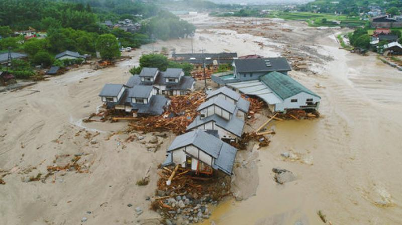 Houses are collapsed and half-buried in the mud following the flooding caused by heavy rain in Asakura, Fukuoka prefecture, southwestern Japan. (Photo: AP)