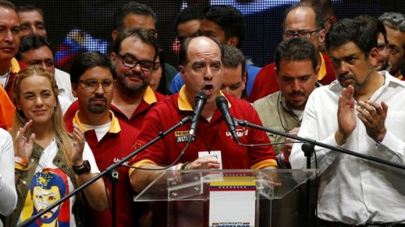 Venezuelan's opposition said more than 7.1 million people responded to its call to vote Sunday in a symbolic rejection of President Nicolas Maduro's plan to rewrite the constitution, a proposal that has raised tensions in a nation suffering through widespread shortages and months of anti-government protests. (Photo: AP)