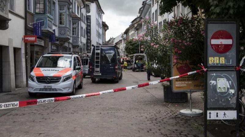 Police shut down the town of Schaffhausen in Switzerland, while they search for an unknown man who attacked people. (Photo: AP)