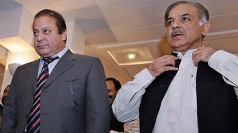 Former Prime Minister Nawaz Sharif with Punjab chief minister Shehbaz Sharif. (Photo: AFP)