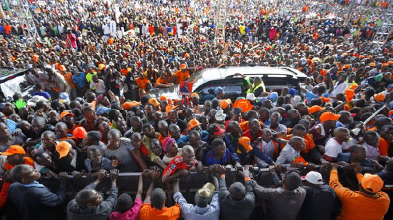 Supporters of opposition leader Raila Odinga surge towards the stage at his final electoral campaign rally in Uhuru Park in downtown Nairobi, Kenya. (Photo: AP)