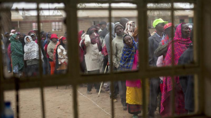 Kenyans line up to vote in Bissil, 120 kms. (75 miles) south of Nairobi, Kenya. Kenyans are going to the polls to vote in a general election after a tightly-fought presidential race between incumbent President Uhuru Kenyatta and main opposition leader Raila Odinga. (Photo: AP)