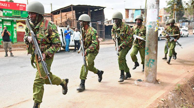Armed Kenyan police to disperse protesters in the Kibera slum in Nairobi on Saturday. (Photo: AFP)