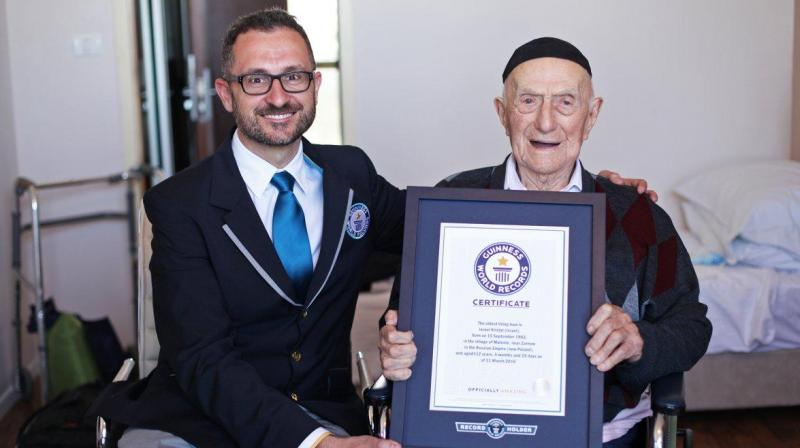 Marco Frigatti, Head of Records for Guinness World Records, presents Yisrael Kristal a certificate for being the oldest living man last year. (Photo: AP)
