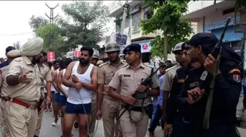The parading of the gangster's aides on Sunday was seen as an attempt by the police to instil fear among criminals and make residents feel safe. (Photo: PTI)