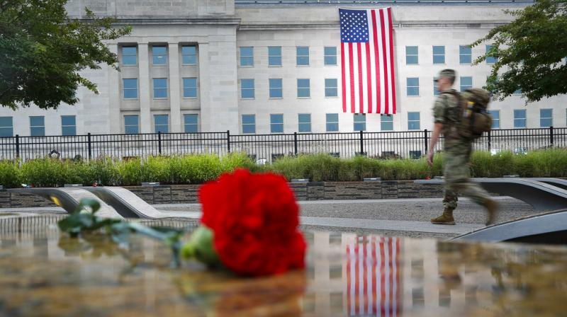 A member of the military walks the grounds of the National 9/11 Pentagon Memorial before the start of the September 11th Pentagon Memorial Observance at the Pentagon on the 17th anniversary of the September 11th attacks. (Photo: AP)