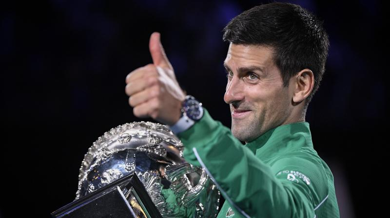 Serbia's Novak Djokovic gestures as he holds the Norman Brookes Challenge Cup after defeating Austria's Dominic Thiem in the final of the Australian Open. AP Photo