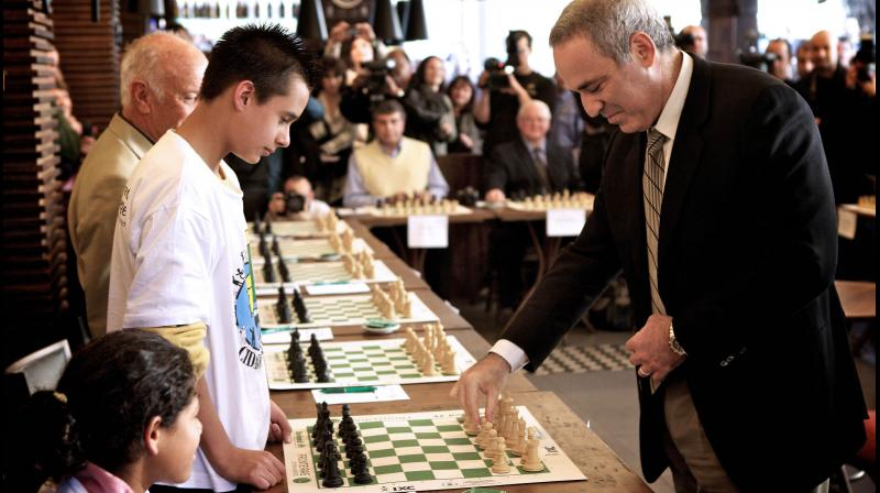 Chess grandmaster and former World Chess Champion Garry Kasparov plays simultaneous chess games with children in Porto Alegre, Brazil. AFP Photo