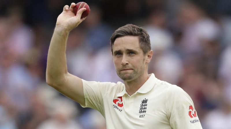 Chris Woakes shows the ball with which he took a match-winning haul as he leaves the pitch after a 143-run against Ireland at Lord's cricket ground in London. AP Photo