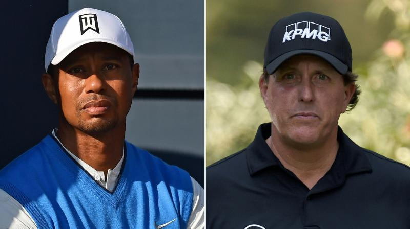 US golfers Tiger Woods and Phil Mickelson are to join NFL superstars Tom Brady and Peyton Manning for a charity golf match. AFP Photo
