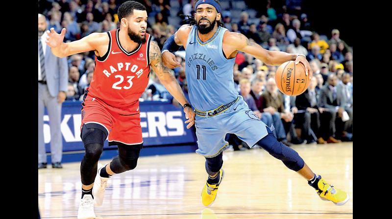 Toronto Raptors guard Fred VanVleet (L) tries to intercept Memphis Grizzlies guard Mike Conley in their NBA game. AP Photo