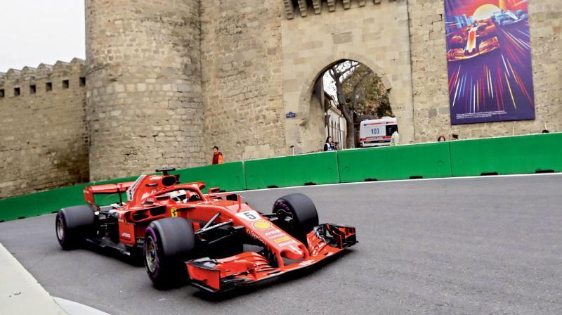 Ferrari's German driver Sebastian Vettel drives during the qualifying at Baku circuit. AFP Photo