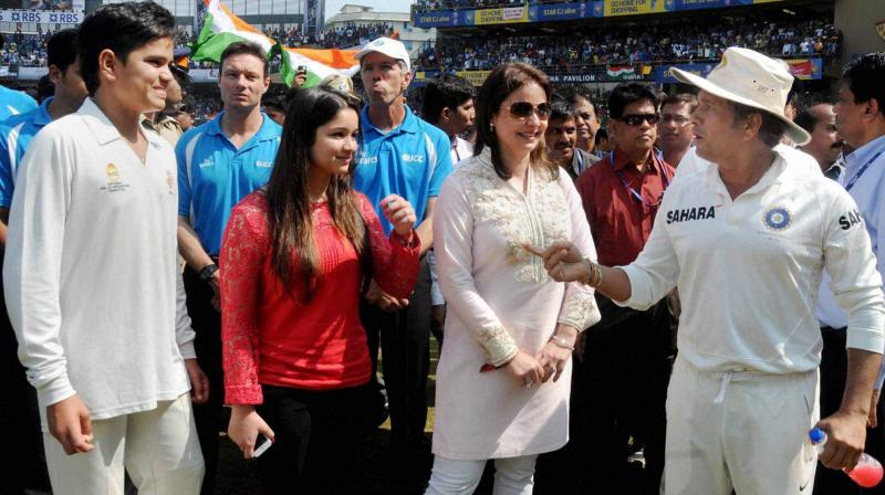 Sachin Tendulkar with his family during his farewell ceremony at Wankhede stadium in Mumbai. PTI Photo