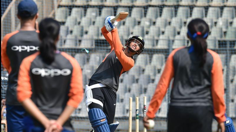 Indian cricketer Smriti Mandhana plays a shot during a practice session. PTI Photo