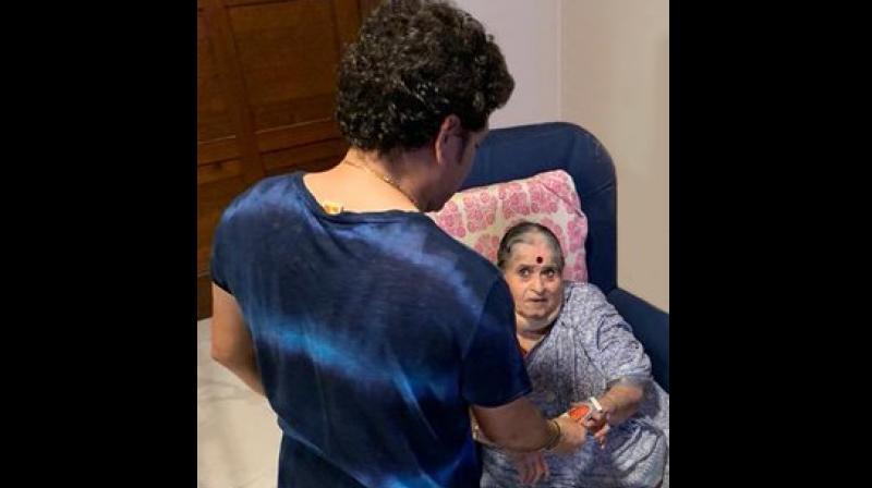 Sachin Tendulkar taking his mother's blessings. Twitter Photo