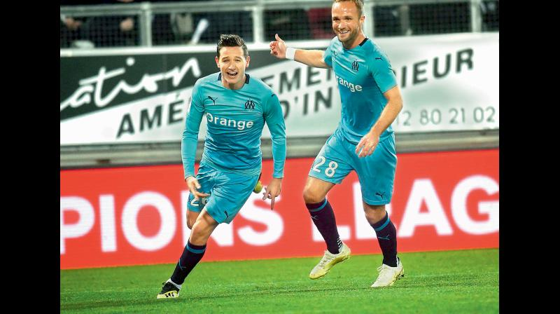 Olympique de Marseille's French midfielder Florian Thauvin celebrates after scoring during the French Ligue 1 match against Amiens. AFP Photo