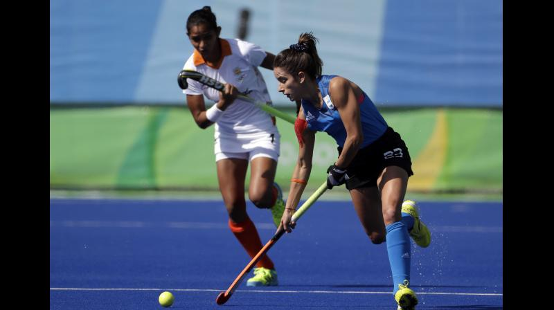 India's Navjot Kaur (L) gives Argentinian Maria Campoy a chase during their 2016 Summer Olympics match in Rio de Janeiro, Brazil. AP Photo