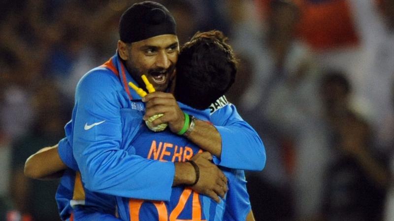 COMRADES IN ARMS: Harbhajan Singh and Ashish Nehra. AFP Photo