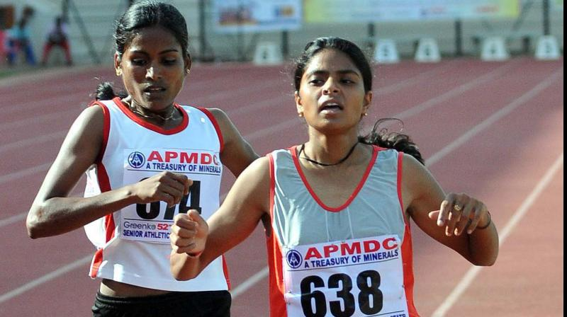 Jharkhand's Jhuma Khatun (R) en route to gold in the women's 1500 metres race at Senior National Inter-State Championships in Hyderabad. DC Photo