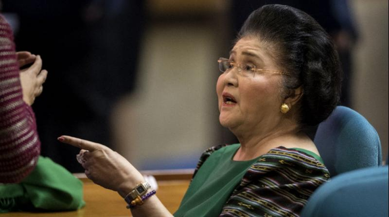 Chaos erupted at Imelda Marcos's 90th birthday party.   (Photo: AFP)