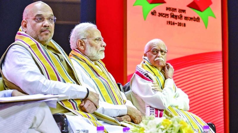 BJP chief Amit Shah, Prime Minister Narendra Modi and senior leader L.K. Advani during the party's national executive meeting in New Delhi. (Photo: PTI)