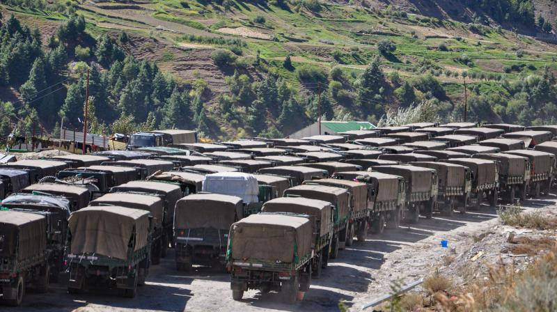 An army convoy carrying military material on its way to Ladakh amid border tension with China, at Manali-Leh highway. — PTI photo