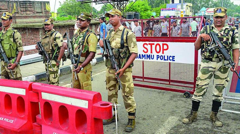 Security personnel maintain vigil at Bikram Chowk in Jammu on Tuesday. (Photo: PTI)