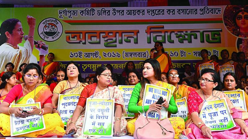 Trinamul Congress MLA Nayna Bandyopadhyay along with the members of Banga Janani Vahini during a protest against income tax notices being served to several Durga Puja committees in Kolkata on Tuesday. (Photo: PTI)