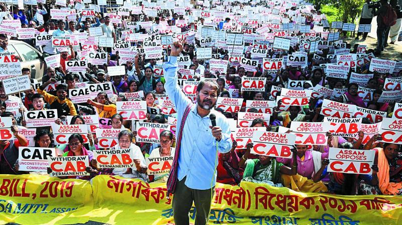 Krishak Mukti Sangram Samiti adviser Akhil Gogoi and supporters raise slogans at a protest against the Citizenship (Amendment) Bill in Guwahati on Friday. (Photo: PTI)