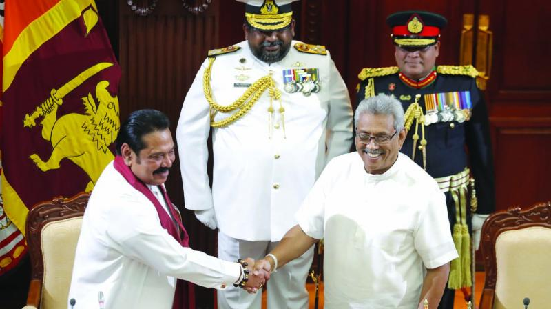 Sri Lanka's President Gotabaya Rajapaksa (right) greets his brother Mahinda after appointing him as Prime Minister at the presidential secretariat in Colombo on Thursday. (Photo: AP)