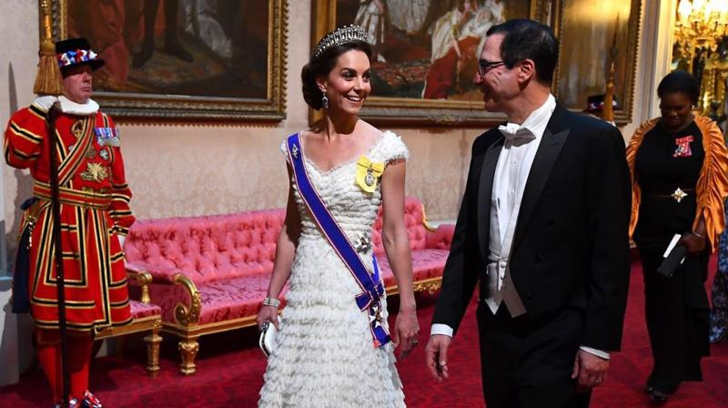 The Duchess wore a blue, red and white sash of the Royal Victorian Order on her shoulder over her stunning white Alexander McQueen gown, marking the first time ever she has worn the new honour. (Photo: AP)