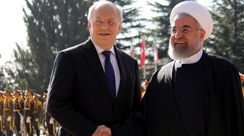 The arrangement was also formalised separately in Riyadh and Tehran. (Photo: AFP)