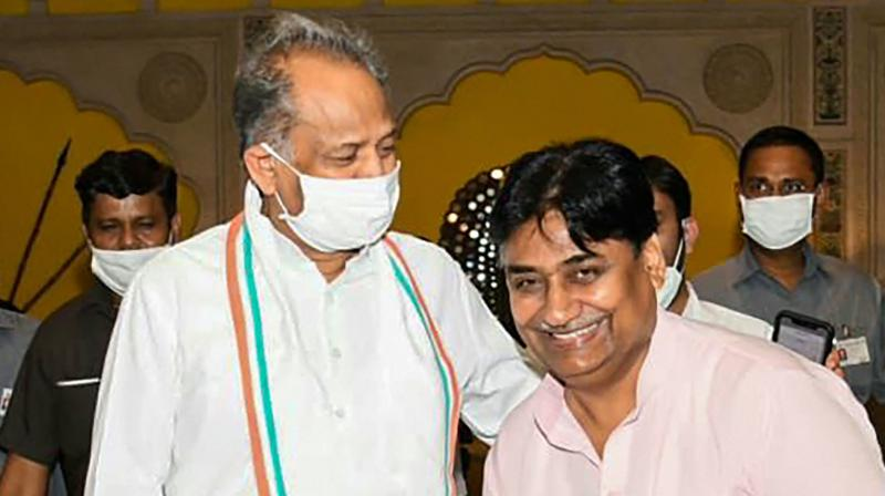 Rajasthan CM Ashok Gehlot and new Congress state president Govind Dotasara.