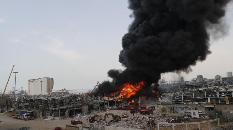 Fire burns in the port in Beirut, Lebanon, Thursday, Sept. 10. 2020. A huge fire broke out Thursday at the Port of Beirut, triggering panic among residents traumatized by last month's massive explosion that killed and injured thousands of people. (AP)