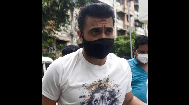 Police escort arrested Bollywood star Shilpa Shetty's husband Raj Kundra. (AFP)