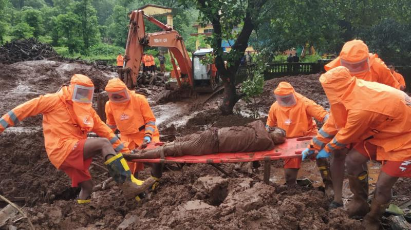 This photograph provided by India's National Disaster Response Force (NDRF) shows NDRF personnel recovering the body of a landslide victim at Ratnagiri in the western Indian state of Maharashtra, Sunday, July 25, 2021. (AP)