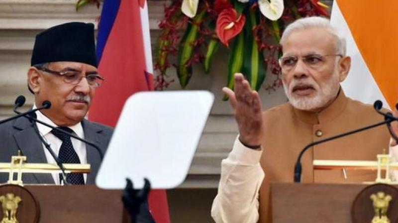 Prime Minister of Nepal Pushpa Kamal Dahal 'Prachanda' with Prime Minister Narendra Modi. (Photo: PTI)