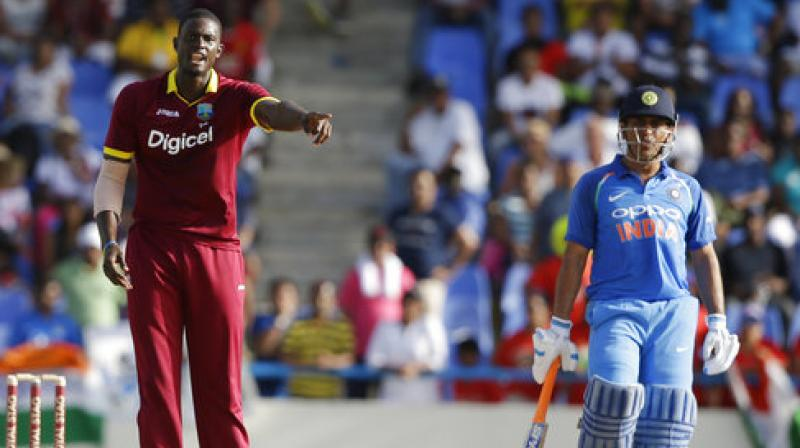 West Indies' captain Jason Holder gives instructions to teammates during the fourth ODI cricket match against India at the Sir Vivian Richards Stadium in North Sound, Antigua and Barbuda. (Photo: AP)