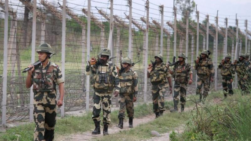 BSF personnel patrolling at the international border. (PTI)