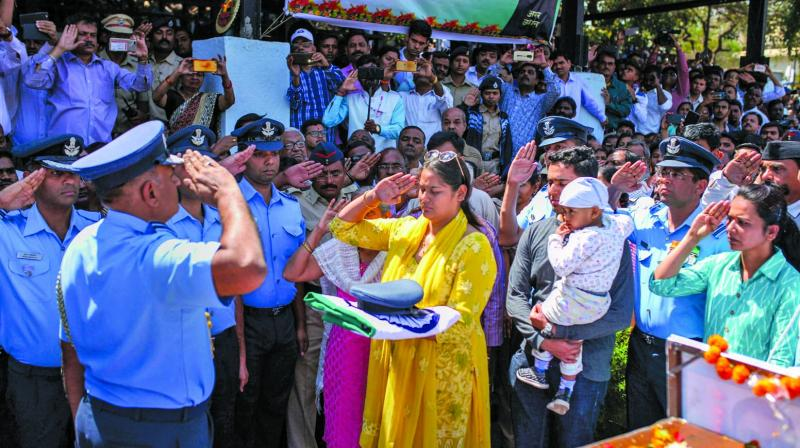 IAF personnel and family members of Squadron Leader Ninad Mandavgane during his funeral in Nashik on Friday. (Photo: PTI)
