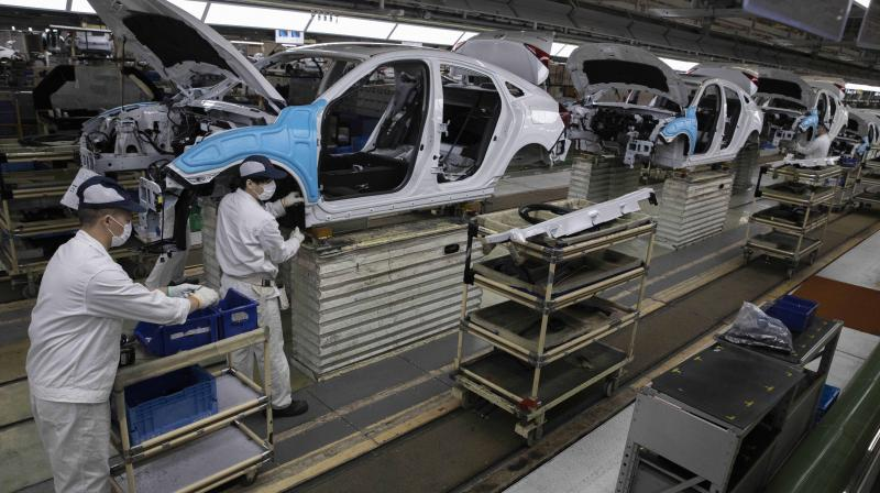 India's factory activity contracts for third straight month in June. (AP Photo)