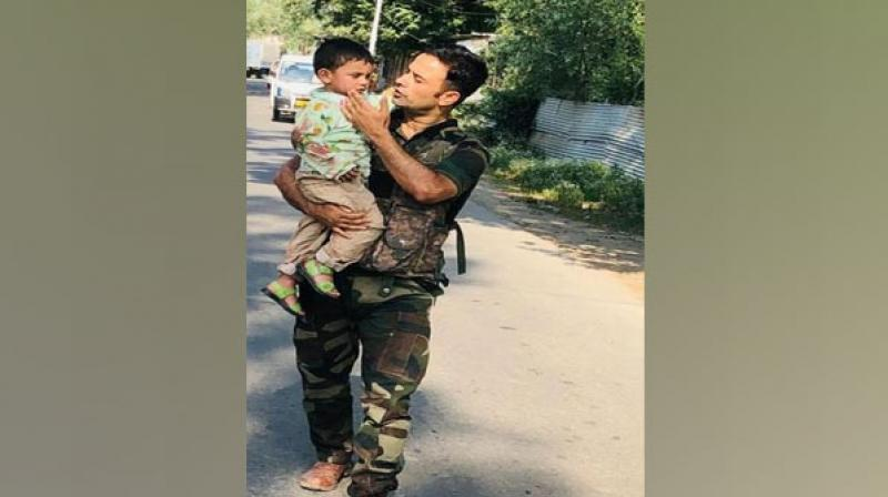 Police rescue 3-year-old boy from bullets in J-K's Sopore. (ANI Photo)