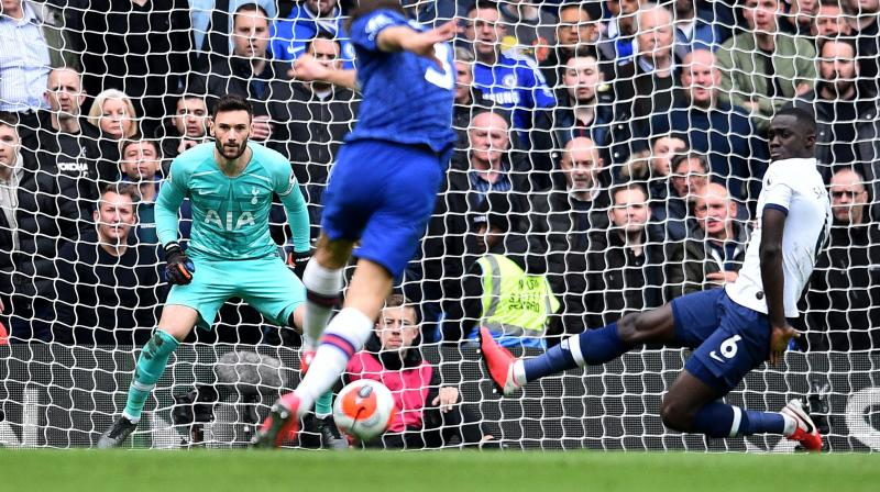 Chelsea's Spanish player Marcos Alonso (centre) scores his team's second goal during the English Premier League football match between Chelsea and Tottenham Hotspur at Stamford Bridge in London on February 22 2020. (AFP)