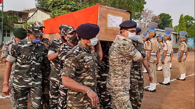 CRPF personnel carry the coffin of a paramilitary soldier who lost his life in an encounter with Maoists, in Bijapur district of Chhattisgarh, Sunday, April 04, 2021. (PTI)