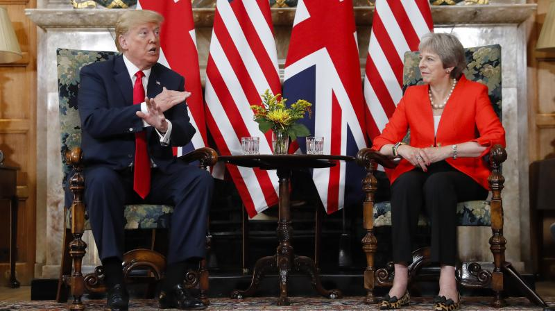 As he began a four-day visit to Britain on Thursday, Trump, a major supporter of Brexit, told The Sun that he had advised May to go about leaving the EU in a different way but was ignored. (Photo: AFP)
