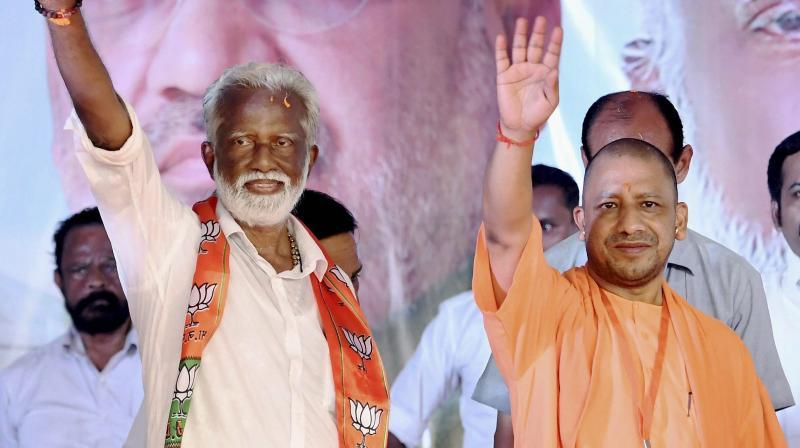 BJP candidate from Thiruvananthapuram K. Rajashekharan with UP CM Yogi Adityanath (Photo: PTI)