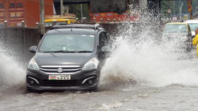 Car wade through flooded street in Mumbai. (Photo: Rajesh Jadhav)