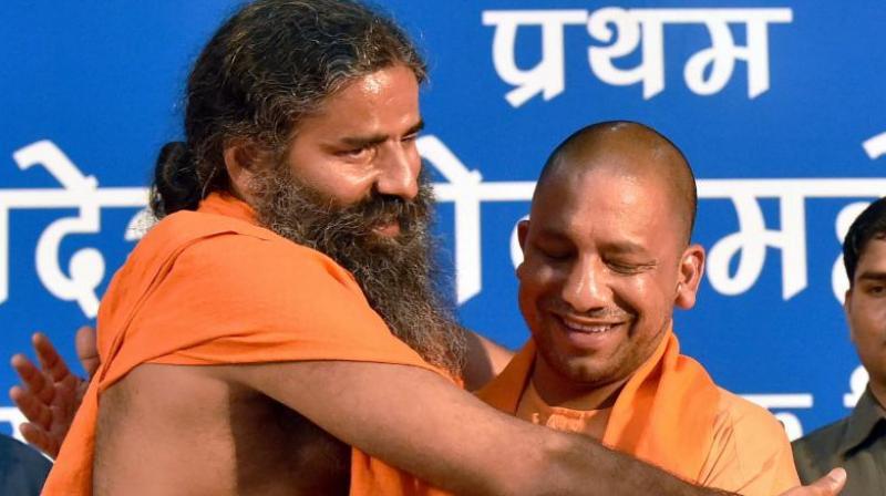 Baba Ramdev and UP CM Yogi Adityanath. (Photo: File)