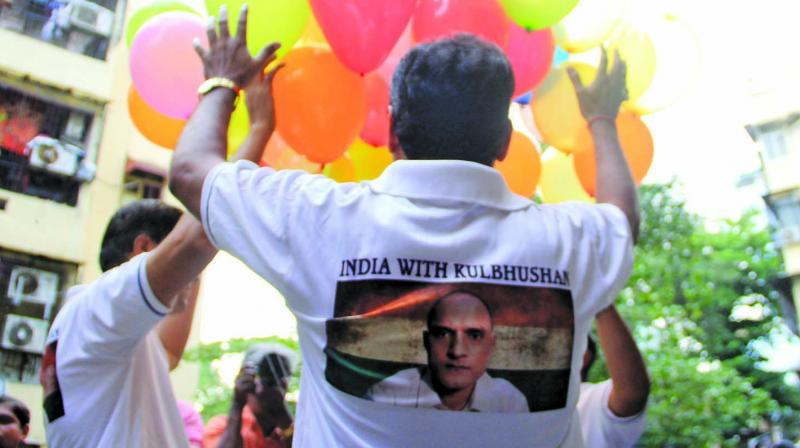 Friends of Kulbhushan Jadhav celebrate the verdict given by International Court of Justice (ICJ) on Wednesday. (Photo: ASIAN AGE)