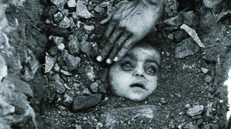 Famous photographer Raghu Rai's picture of a victim child's burial
